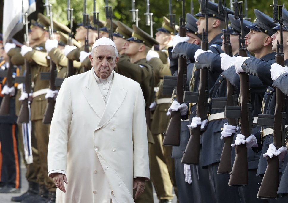 (AP Photo/Andrew Medichini) Pope Francis reviews the honor guard during the welcome ceremony at the Kadriorg Presidential Palace, Estonia, Tuesday, Sept. 25, 2018. Pope Francis concludes his four-day tour of the Baltics visiting Estonia.