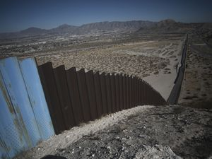 (Christian Chavez | AP) An older section of the border wall divides Ciudad Juarez, Mexico, from Sunland Park, New Mexico, top, on the outskirts of Ciudad Juarez, Mexico, Tuesday, Jan. 12, 2021.
