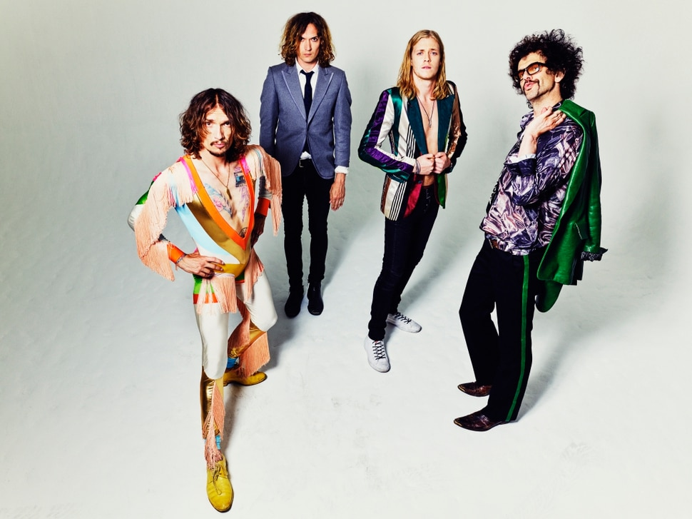 (Photo courtesy of Simon Emmett) British rock band The Darkness consists of (from left): vocalist/guitarist/keyboardist Justin Hawks, guitarist Dan Hawkins, drummer/vocalist Rufus Taylor, and bassist Frankie Poullain.