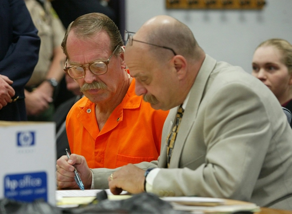 (Stuart Johnson | AP pool) Ron Lafferty, left, and Ron Yengich, Laffertys new defense attorney review the official notice proclaiming Yengich as Laffertys new attorney, Wednesday, Sept. 25, 2002, in Provo, Utah. Lafferty who is on death row for his part in killing his sister-in-law and baby niece July 24, 1984.