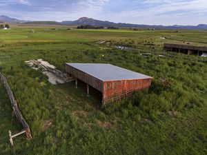 (Leah Hogsten | The Salt Lake Tribune) The 150-acre Panguitch Research Farm, still in operation Aug. 12, 2021, is the former location of the Panguitch Boarding School for mostly the Kaibab Band of Paiutes in Arizona and the Shivwitz Band of Paiute Indians of Utah that operated from 1904 to 1909. In 1909, the property once owned by the U. S. government was transferred to the state of Utah where the land was used for experimental high-altitude farming. Today, it sits mostly vacant, except for the dilapidated lone brick building, at left in the distance, that dates back to the 1900's.