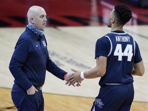Utah State head coach Craig Smith, left, greets Utah State's Marco Anthony during the first half of an NCAA college basketball game against Utah State, Wednesday, Jan. 27, 2021, in Las Vegas. (AP Photo/John Locher)