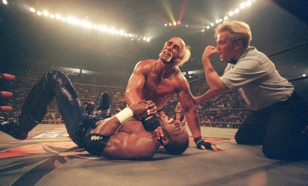 Tribune file photo Hollywood Hulk Hogan puts a choke hold on the neck of Utah Jazz basketball star Karl Malone at a pay-per-view wrestling match Sunday July 12, 1998 in San Diego.