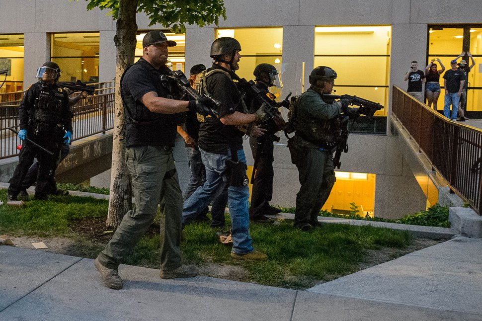(Trent Nelson | The Salt Lake Tribune) Police move in to make an arrest after a protest against police brutality turned violent in Salt Lake City on Saturday, May 30, 2020.