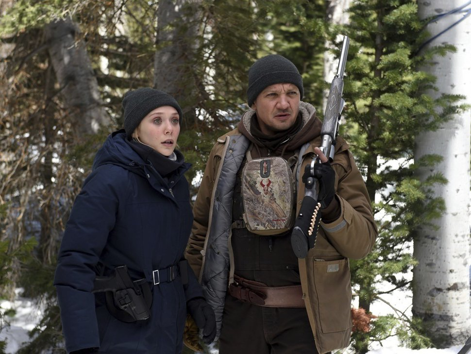 This image released by The Weinstein Company shows Elizabeth Olsen, left, and Jeremy Renner in a scene from