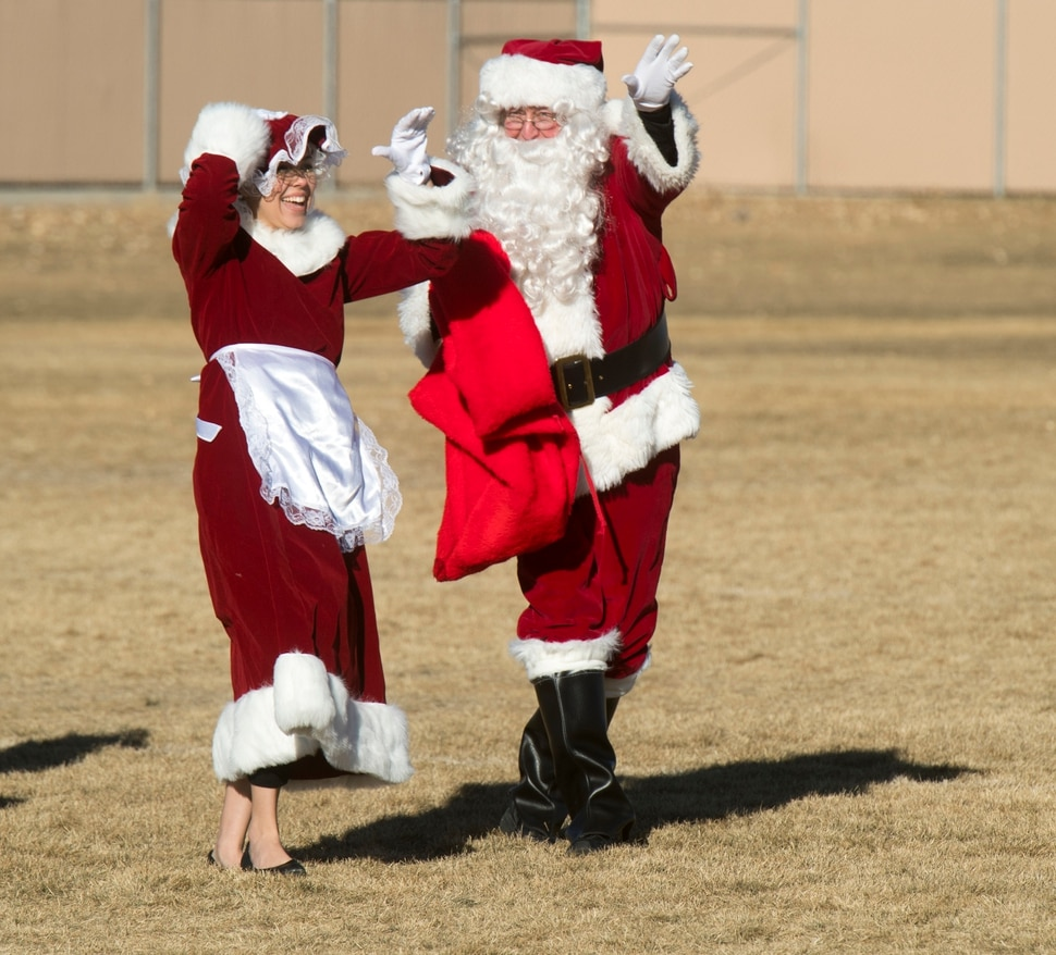 Kids Cheer As Santa Flight Delivers Holiday Gifts, School