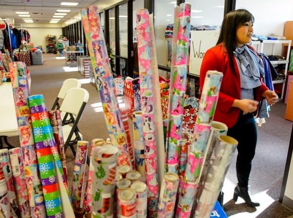 (Steve Griffin | The Salt Lake Tribune) Yen Nguyen, of YWCA Utah, inside Candy Cane Corner in Salt Lake City Thursday December 7, 2017. Candy Cane Corner gives struggling families a way to have a happy holiday experience. Low-income parents who are participating in programs at The Road Home, Volunteers of America, Utah, and the YWCA can select gifts for their children and themselves at the store and wrap them there. The store is stocked with new toys, clothing and housewares that are donated by community members.