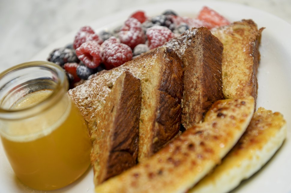 Leah Hogsten | The Salt Lake Tribune Beaumont Bakery & Cafe's French toast with berries, banana bržlŽe and brown buttered bourbon syrup.