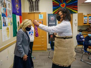 (Trent Nelson  |  The Salt Lake Tribune) Ilai Kaufusi presents first lady Jill Biden with a traditional lei at Glendale Middle School in Salt Lake City on Wednesday, May 5, 2021.
