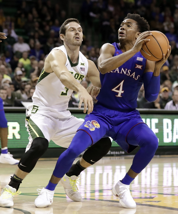 Tony Gutierrez/AP Baylor guard Jake Lindsey (3) defends as Kansas's Devonte' Graham (4) works for a shot opportunity during the first half Feb. 10 in Waco, Texas.