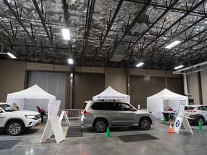 (Francisco Kjolseth  | The Salt Lake Tribune) People line up for the vaccine on Thursday, March 18, 2021, as the Utah Film Studios in Park City loans its space to the Summit County Health Department as a drive-thru COVID-19 vaccination station.