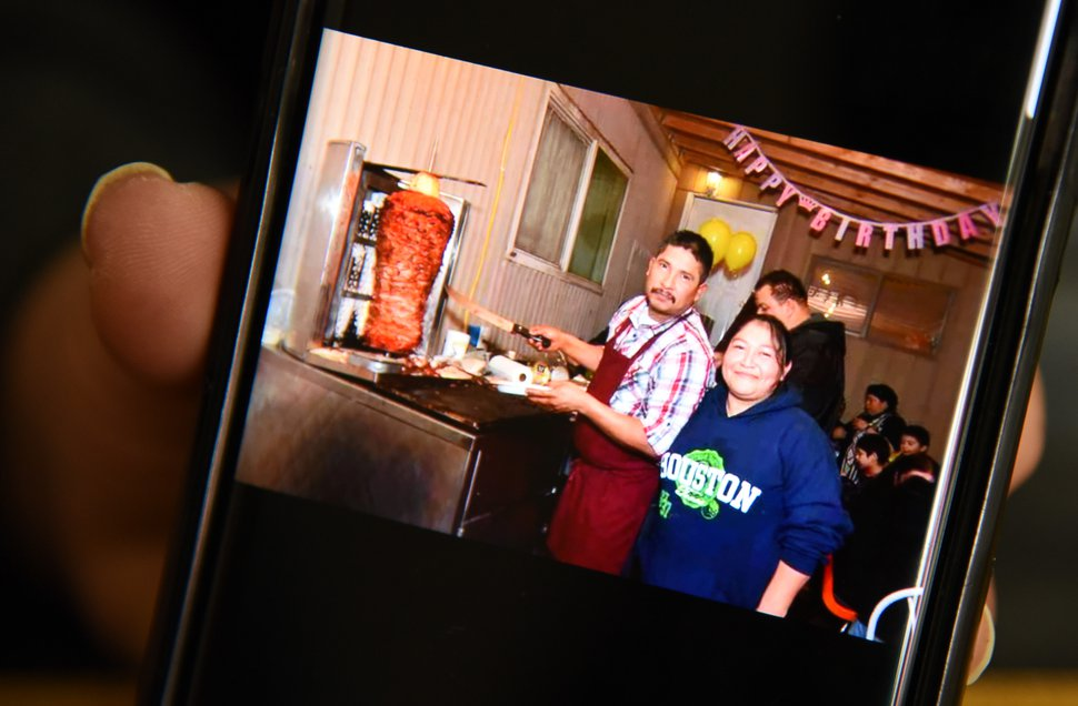 (Francisco Kjolseth | The Salt Lake Tribune) Carolina Marquez shows off photos on her phone of her late husband, Adrian de los Santos Luna, when they were first starting out selling tacos outside their home in West Valley City.