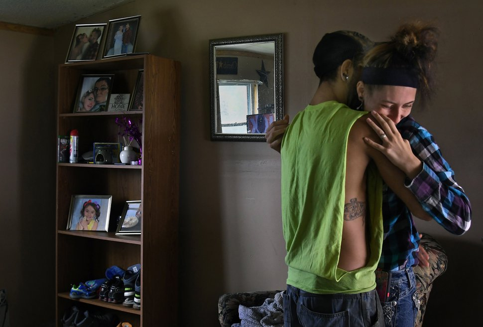 (Washington Post photo by Michael S. Williamson) Maria gives a goodbye hug to her husband Phil before he heads off to work.