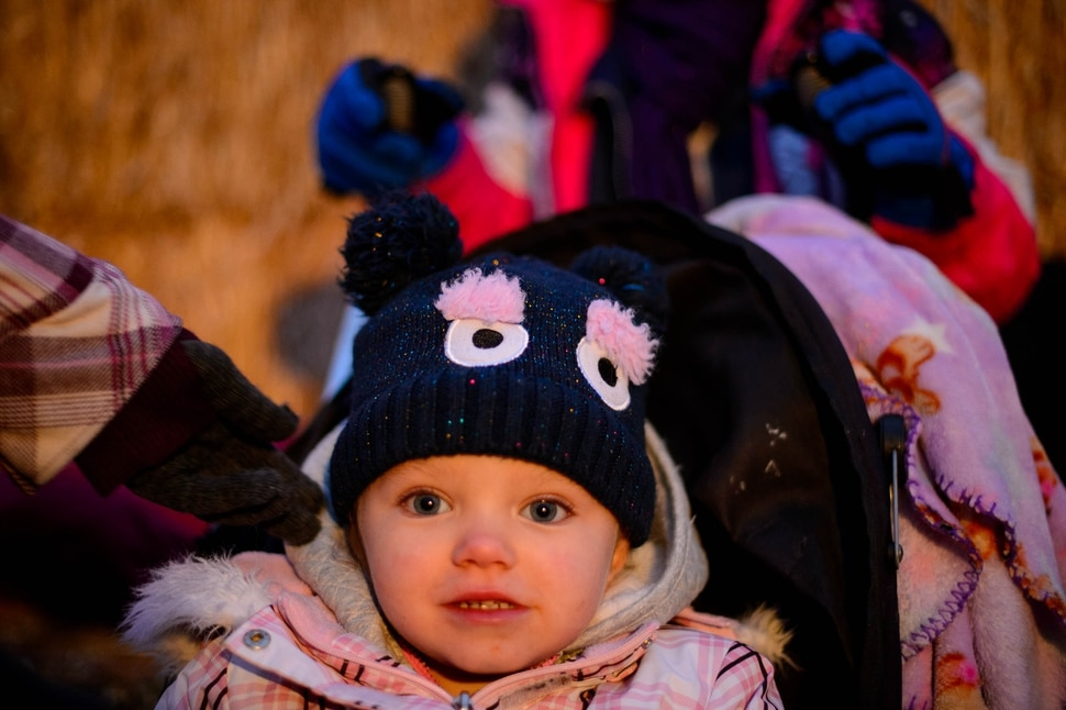 (Trent Nelson | The Salt Lake Tribune) Charlotte Richins, 3, bundled up for a cold night at Pumpkin Nights at the Utah State Fairpark in Salt Lake City on Monday, Oct. 28, 2019.