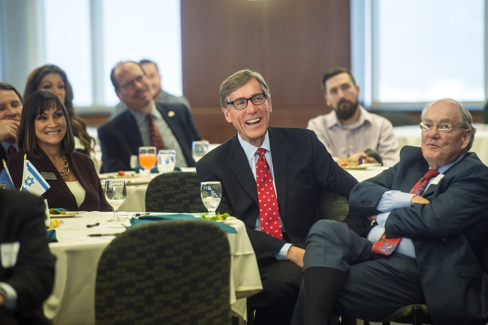 Chris Detrick | The Salt Lake Tribune Zions Bank President and CEO Scott Anderson laughs while Governor Gary R. Herbert speaks during the Utah Israel Economic Council Meeting Tuesday February 9, 2016.