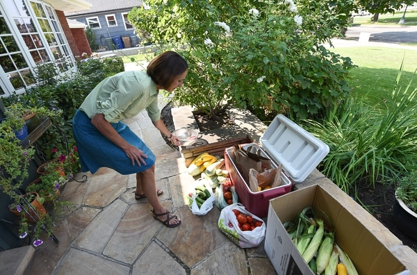 (Francisco Kjolseth | The Salt Lake Tribune) Pat Thomas is the founder of Backyard GardenShare, a grass-roots program that finds volunteers willing to collect excess garden tomatoes, zucchini, peppers and more from their neighbors and then deliver to pantries, schools and churches that will distribute the food to people in need. On the porch of her home she keeps a cooler for those dropping off donations.