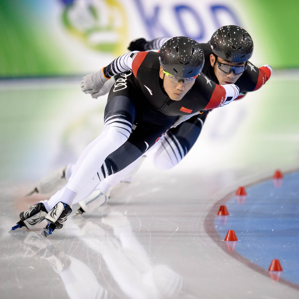 (Trent Nelson | The Salt Lake Tribune) China races to the silver medal in the Men's Team Sprint at the ISU World Single Distances Speed Skating Championships at the Utah Olympic Oval in Kearns on Thursday, Feb. 13, 2020. From left, Tingyu Gao, Shiwei Wang.