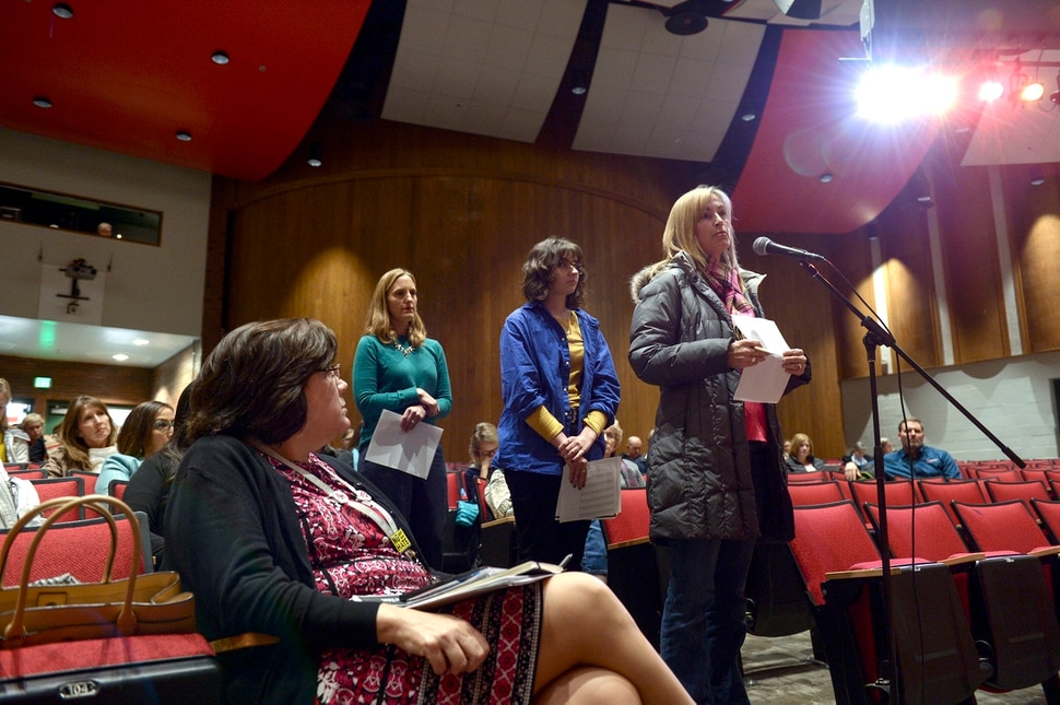 (Leah Hogsten | The Salt Lake Tribune) Colleen Santelli, right, questions the school board members Monday night. The Salt Lake City Board of Education kicked off a listening tour Jan. 13, 2020 at Bryant Middle School to hear from students and parents about the possibility of implementing later school start times for the Salt Lake City school district high schools.