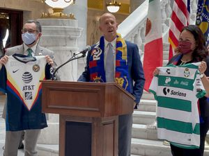 (Alex Vejar   The Salt Lake Tribune) Real Salt Lake Interim President John Kimball, center, asen. Luz Escamilla, right, and Consul General José Borjón announce that Liga MX teams Club América and Santos Laguna will play at Rio Tinto Stadium on July 4 during an event held at the state Capitol building on Monday, May 24, 2021.