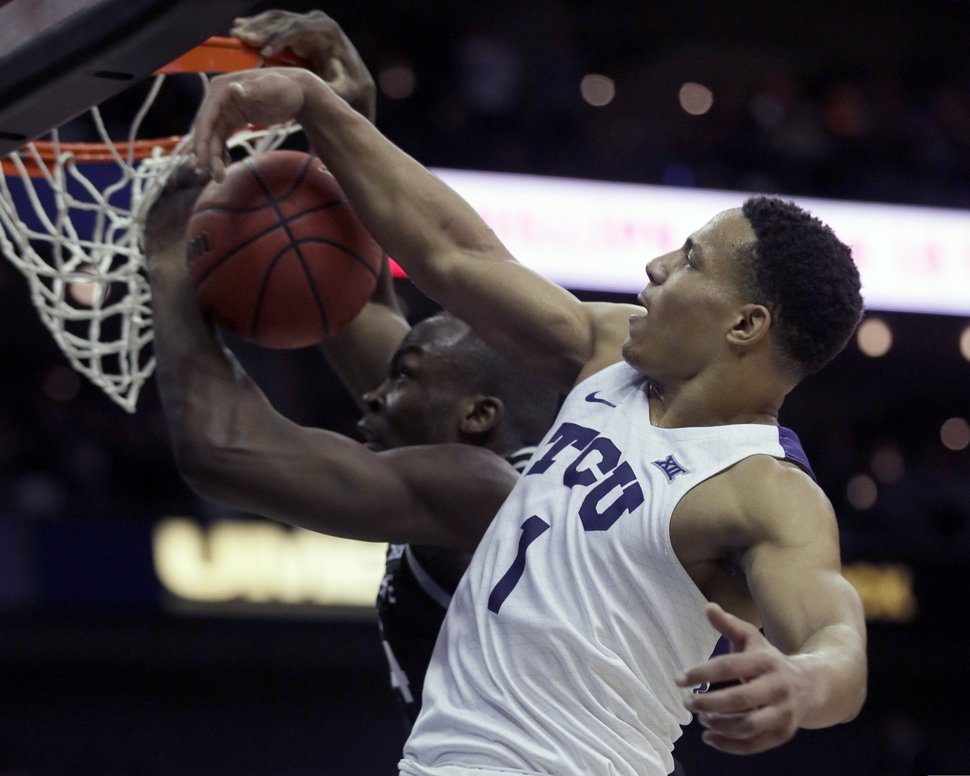 TCU guard Desmond Bane (1) blocks a shot by Kansas State forward Makol Mawien, left, during the first half of an NCAA college basketball game in the first round of the Big 12 men's basketball tournament in Kansas City, Mo., Wednesday, March 11, 2020. (AP Photo/Orlin Wagner)