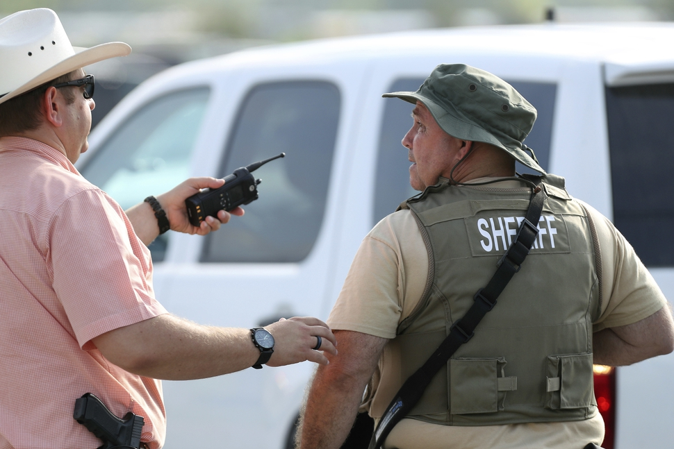 Law enforcement officers respond to an active shooter in front of Santa Fe High School Friday, May 18, 2018, in Santa Fe, Texas. (Steve Gonzales/Houston Chronicle via AP)