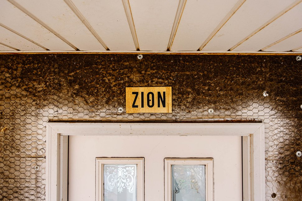 Trent Nelson | The Salt Lake Tribune A sign reading Zion over the front door of a Hildale home owned by the United Effort Plan trust that Shawn and Alexandra Stubbs hope to move into, Saturday February 11, 2017. The signs are put on homes occupied by members of the FLDS church.