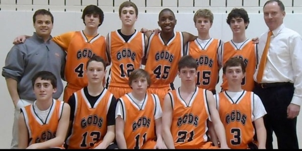 Donovan Mitchell, No. 45, poses with his 9th grade basketball team at Greenwich Country Day School. Mitchell attended the Connecticut private school between 3rd and 9th grade. Courtesy of Nicole Mitchell.