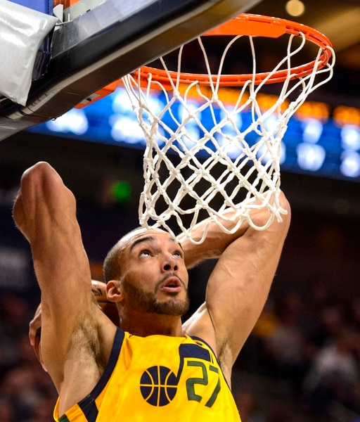 (Steve Griffin | The Salt Lake Tribune) Utah Jazz center Rudy Gobert (27) throws down a dunk during the Utah Jazz versus Detroit Pistons at Vivint Smart Home Arena in Salt Lake City Tuesday March 13, 2018.