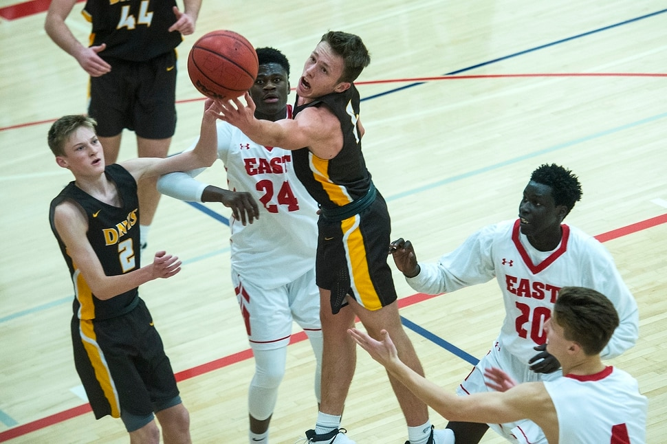 (Chris Detrick | The Salt Lake Tribune) Davis' Josh SandersÊ(5) East's Andre Mulibea (24) East's Jeremy Jiba (20) East's Taylor Zwick (4) and Davis' Trevan Leonhardt (2) go for a rebound during the game at East High School Thursday, December 14, 2017.