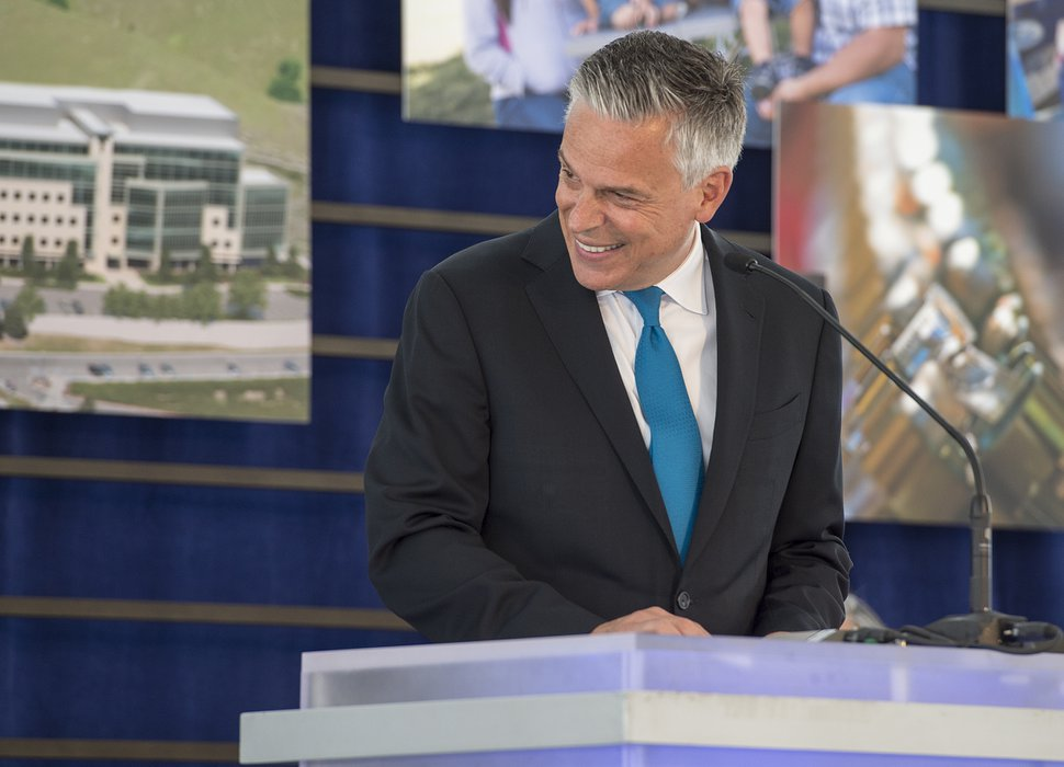 Leah Hogsten | The Salt Lake Tribune Jon M. Huntsman, Jr., United States Ambassador to Russia and former Utah Governor laughs with his parents Jon M. Huntsman and Karen Huntsman during the dedication ceremony of the Primary ChildrenÕs and FamiliesÕ Cancer Research Center, June 21, 2017. Huntsman Cancer Institute (HCI) dedicated the Primary ChildrenÕs and FamiliesÕ Cancer Research Center, a world-class facility dedicated to advancing cancer research and patient care.