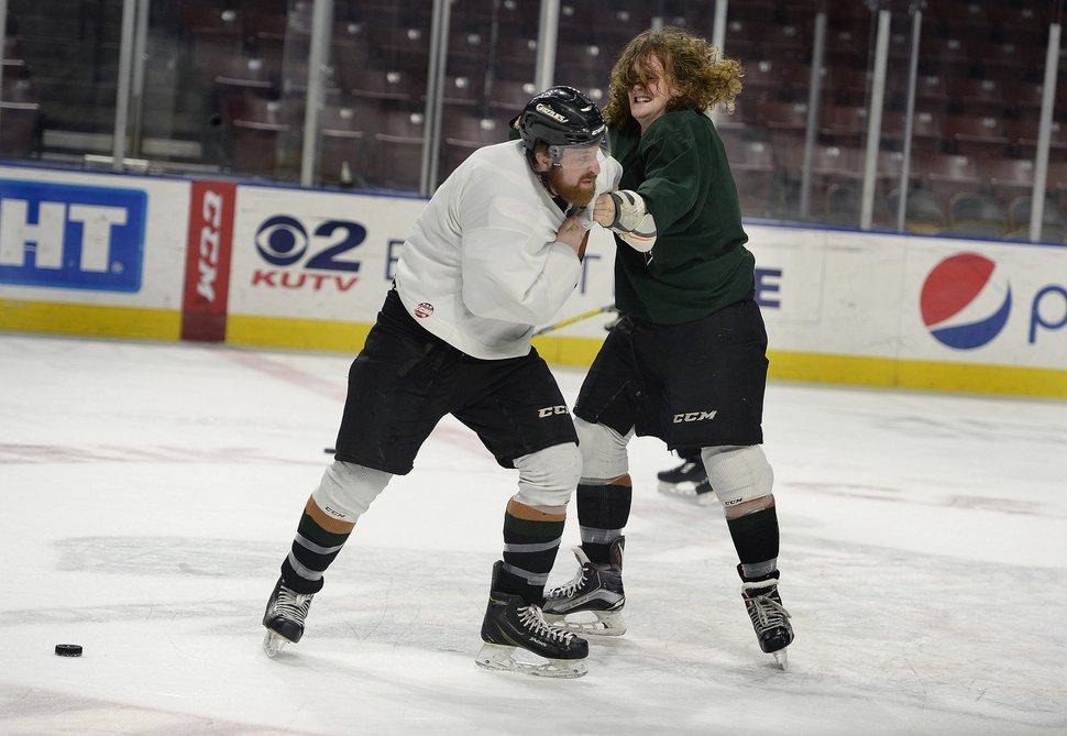 Scott Sommerdorf   The Salt Lake Tribune Utah Grizzlies hockey player Travis Howe jokes around fighting with a team mate during practice, Thursday, March 2, 2017.