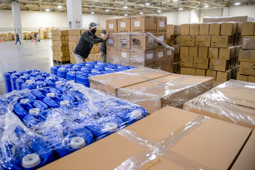 (Trent Nelson | The Salt Lake Tribune) Workers organize supplies at the Receiving, Staging and Shipping Center at the Salt Palace Convention Center in Salt Lake City on Friday, May 8, 2020. The center serves as a central location for personal protective equipment received by the State of Utah and sent to hospitals, local health departments and emergency managers.