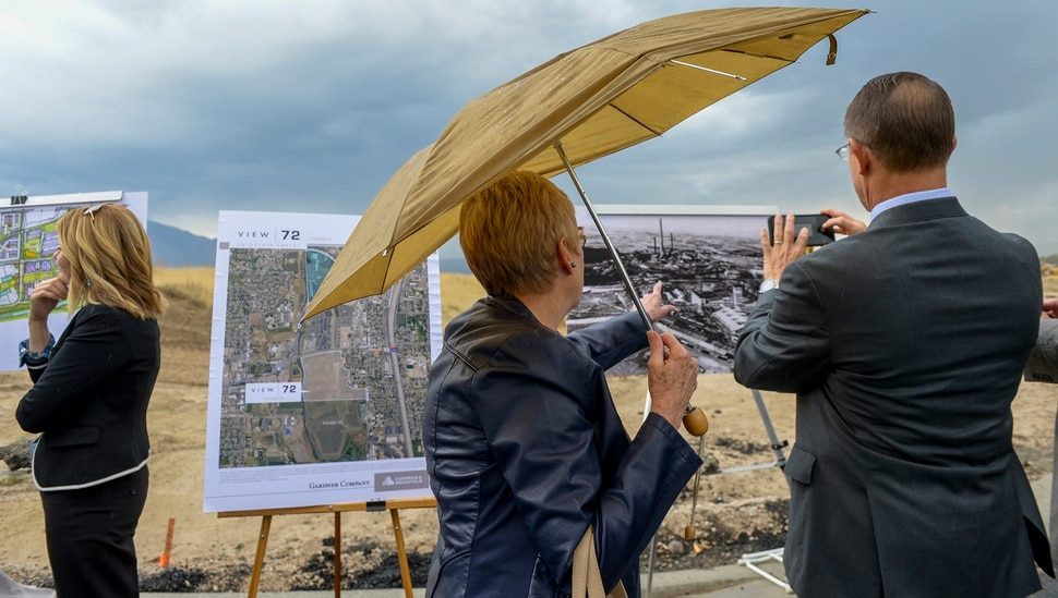 Leah Hogsten | The Salt Lake Tribune l-r Jan Litster and Ken Ivory, R-West Jordan look at an old photograph of the Sharon Steel mill that operated on the site from 1906 to 1971 after the Midvale ceremony, Monday, Oct. 22, 2018. Jordan Bluffs is moving forward with the View 72, Phase II development at Jordan Bluffs. The 265-acre parcel will be comprised of mixed-use development on the former Sharon Steel superfund industrial site.