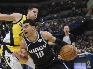 Sacramento Kings guard Justin James (10) goes around Indiana Pacers forward Doug McDermott (20) during the first half of an NBA basketball game in Indianapolis, Friday, Dec. 20, 2019. (AP Photo/AJ Mast)