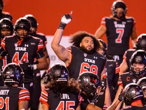 (Trent Nelson  |  The Salt Lake Tribune) The Utah Utes warm up as they prepare to host the USC Trojans, NCAA football at Rice-Eccles Stadium in Salt Lake City on Saturday, Nov. 21, 2020.