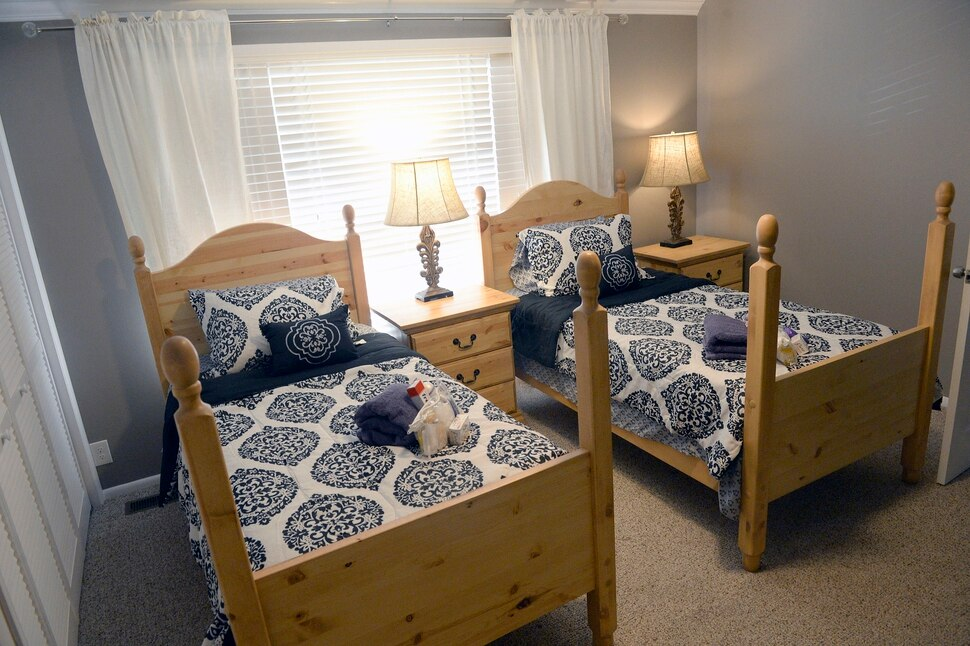 (Al Hartmann | The Salt Lake Tribune) Example of a double bedroom at a residential house in Murry for a new sober living housing program Monday Jan. 29. The combined county and state funded program places people in safe, affordable housing while continuing to receive treatment for substance use. The residential home is now open in Murray providing space for 12 residents