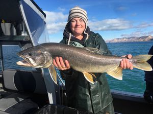 (Photo courtesy of Utah Division of Wildlife Resources) Utah DWR fisheries technician Emily Wright displays a massive lake trout caught and released in Bear Lake during a gillnetting survey in 2019.
