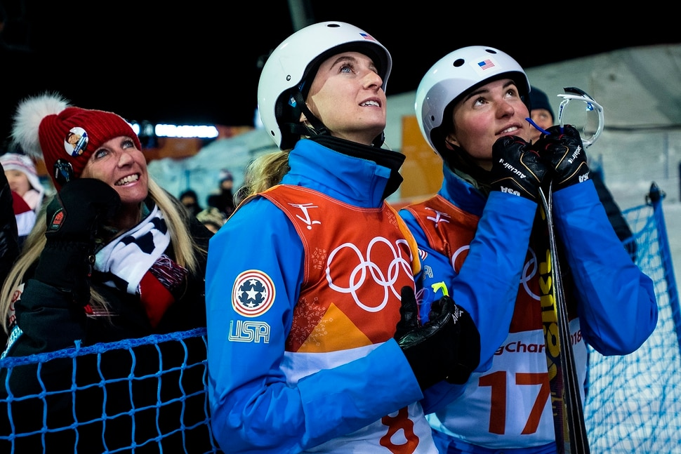 (Chris Detrick | The Salt Lake Tribune) USA Kiley McKinnon, left, and USA Madison Olsen watch the final run to see if Olsen would qualify for the finals during the Ladies' Aerials Qualification at Phoenix Park during the Pyeongchang 2018 Winter Olympics Thursday, Feb. 15, 2018.