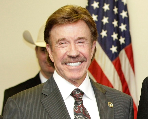 In this Dec. 2, 2010, file photo, actor Chuck Norris stands after a ceremony in Garland, Texas. (AP Photo/Tony Gutierrez, File)