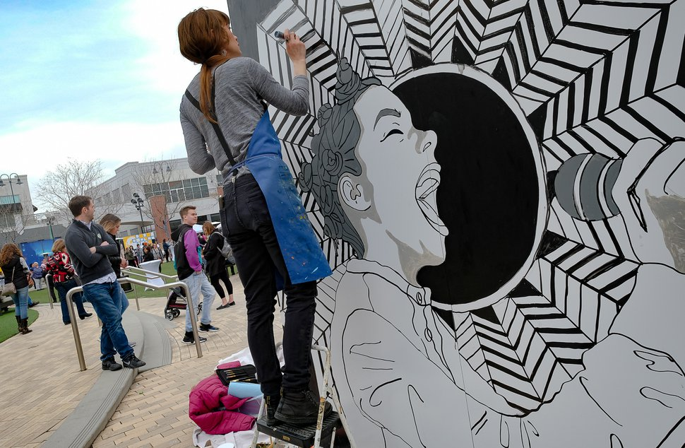 (Francisco Kjolseth | The Salt Lake Tribune) Brooklyn Ottens works on a painting of Bjork as The Gateway, KRCL Radio and The Blocks partner up to celebrate women in music on International WomenÕs Day with the