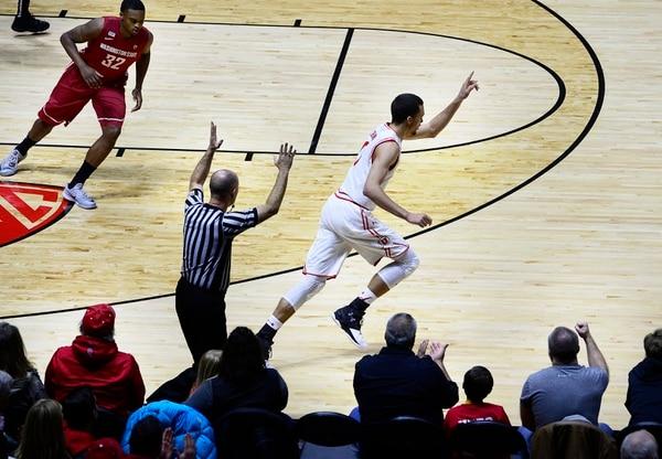 Scott Sommerdorf   The Salt Lake Tribune Utah Utes forward Brekkott Chapman (0) celebrates hitting a 3-pointer as he runs up court during first half play. Utah routed Washington State 88-47, Sunday, February 14, 2016.
