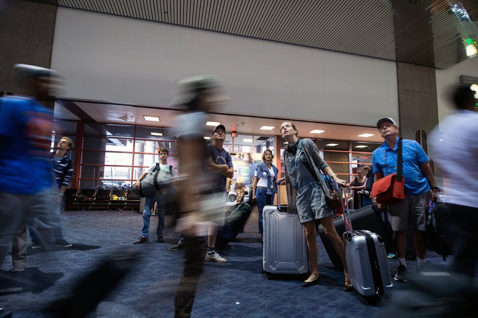 (Brandon Magnus | The New York Times) Travelers at McCarran International Airport in Las Vegas on Aug. 4, 2016. Some airlines have made it easier for travelers to qualify for elite status.