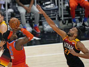 Oklahoma City Thunder forward Luguentz Dort (5) shoots as Utah Jazz center Rudy Gobert (27) defends during the first half of an NBA basketball game Tuesday, April 13, 2021, in Salt Lake City. (AP Photo/Rick Bowmer)