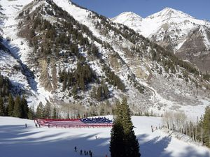 (Al Hartmann  |  Salt Lake Tribune file photo) A view of the Bearclaw run at Sundance Mountain Resort, when a group called Follow the Flag had a 150-foot long American flag taken down the slope  by skiers in 2018. Actor, filmmaker and activist Robert Redford announced Friday, Dec. 11, 2020, that he is selling the resort he opened in 1969 to two investment companies, Broadreach Capital Partners and Cedar Capital Partners, for an undisclosed sum.