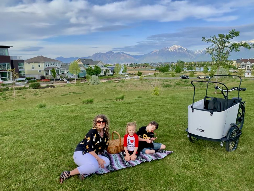 (Photo courtesy of the West family) Tristin West and her children Jayson, 8, and Cozette, 3, stop for a picnic near their home in South Jordan. Jayson has a rare genetic mutation that has rendered him nonverbal, dependent on oxygen and immunocompromised. The family self-quarantines each flu season, from October to May, but the threat of COVID-19 has extended that isolation indefinitely.