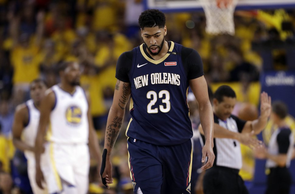 New Orleans Pelicans' Anthony Davis walks back to the bench during a break in the action during the first half in Game 1 of the team's NBA basketball second-round playoff series against the Golden State Warriors on Saturday, April 28, 2018, in Oakland, Calif. (AP Photo/Marcio Jose Sanchez)