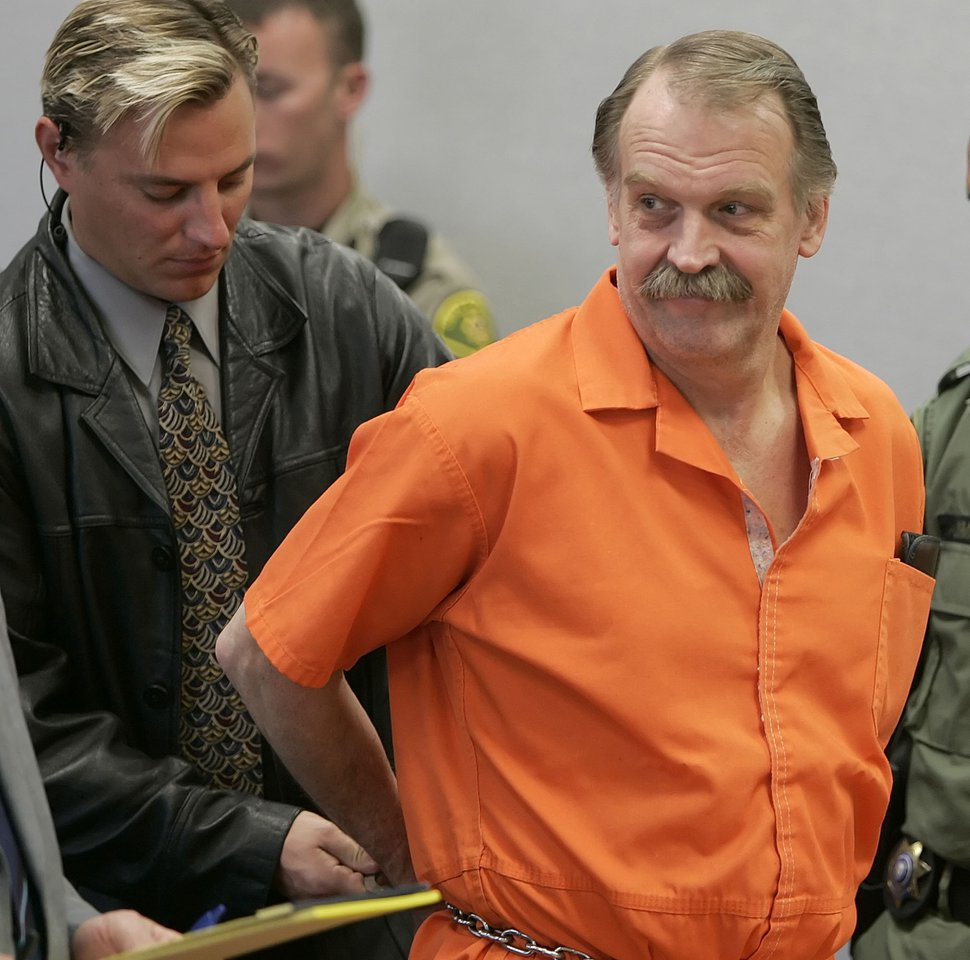 (George Frey | AP file photo) In this Oct. 6, 2005 photo, convicted murderer and death row inmate Ron Lafferty is handcuffed after his court hearing in a courtroom in Provo, Utah. A judge denied an appeal from Lafferty who argued that his sentence of death by firing squad is cruel and unusual punishment.