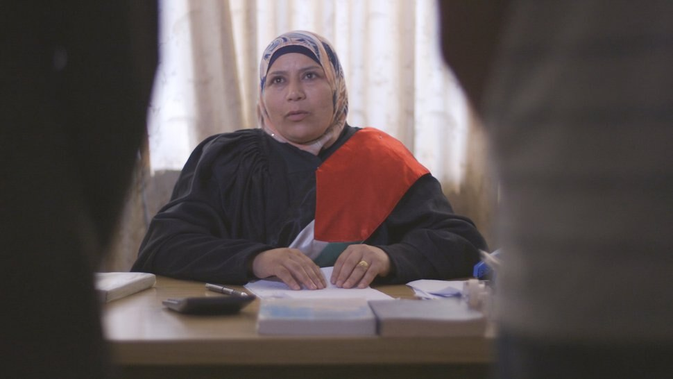 (courtesy Idle Wild Films) Kholoud al-Faqih, the first woman judge of a Palestinian Sharia court, hears a case in a scene from filmmaker Erika Cohn's documentary
