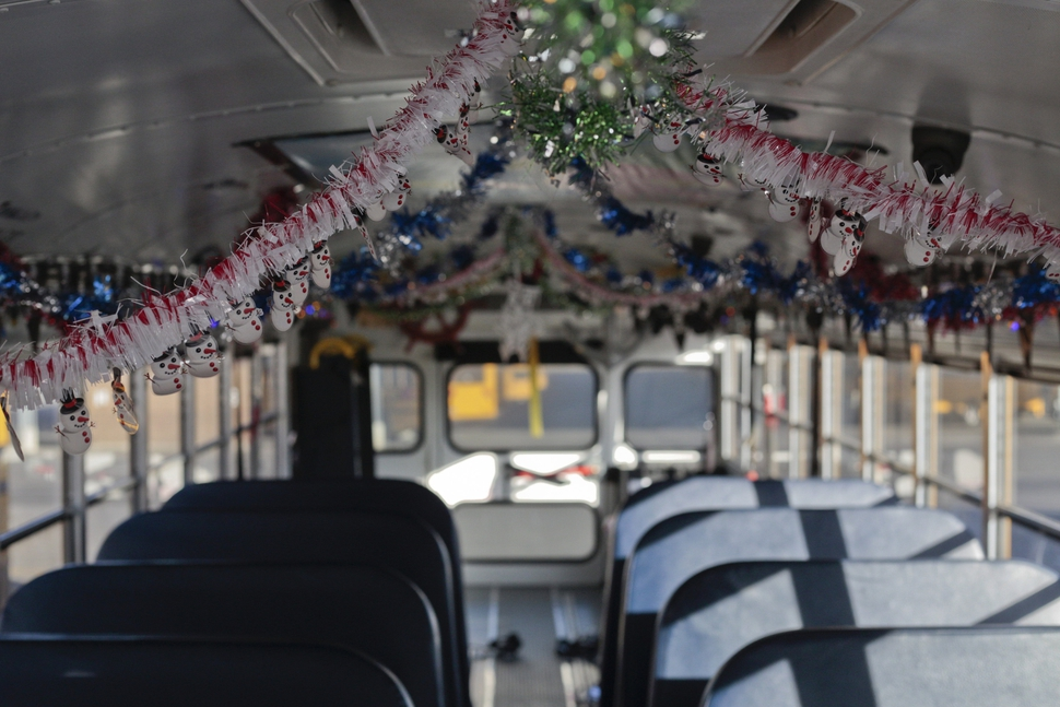 A bus that Don Fitch drives is decorated for Christmas on Tuesday, Dec. 19, 2017 in American Fork, Utah. I've been decking the halls a bit at a time, Don Fitch said. He has driven school buses for the Alpine School District for the past four years. Every year around Christmas, he decorates the bus's interior with Christmas decorations, plays Christmas music and dresses up as Santa. (Evan Cobb /The Daily Herald via AP)