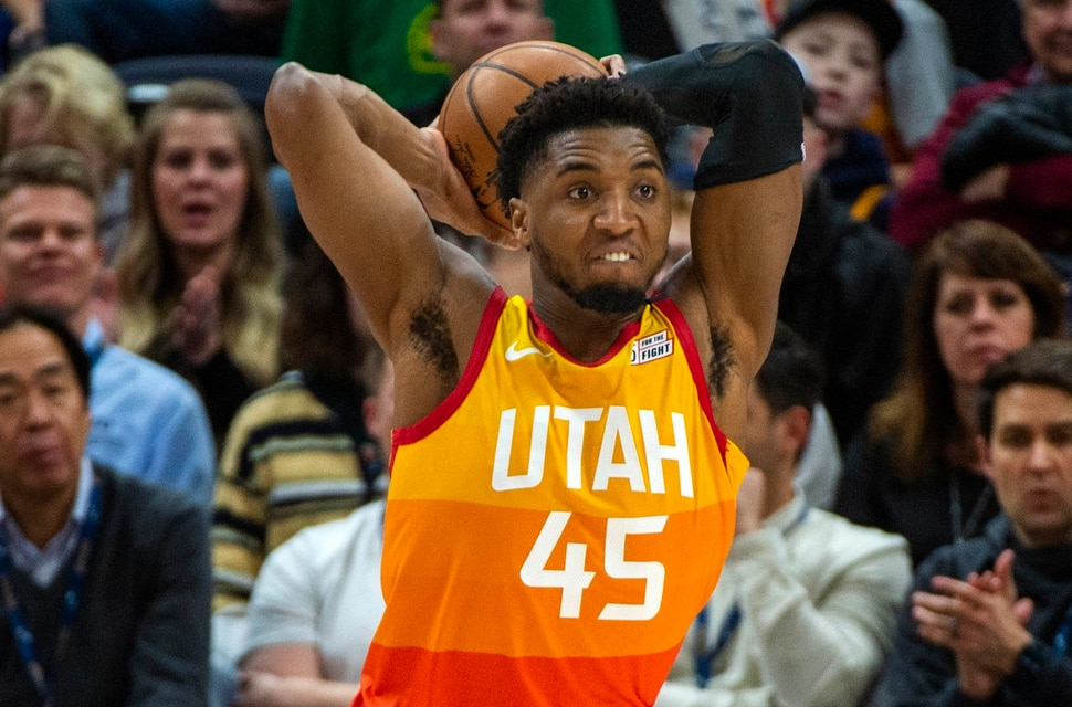 (Rick Egan | The Salt Lake Tribune) Utah Jazz guard Donovan Mitchell (45) those the ball down court after grabbing a rebound, in NBA action between the Utah Jazz and thePortland Trail Blazers in Salt Lake City, Friday, Feb. 7, 2020.